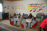The classroom of the Kindergarten, with the little students during their lesson