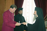 His Beatitude offers to Mr. Hiltz a book of manuscripts of the Patriarchal Library